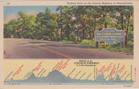 The postcards of the large marker at Bald Knob Summit from different times show the two different paint schemes used by the Department of Highways at different periods.