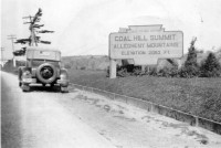 This photograph from the 1930s again demonstrates how familiar the keystone marker shape was in the Commonwealth from the 1910s until well after the Second World War. While this sign, announcing to motorists on the Lakes-to-Sea Highway that they had reached the Coal Hill Summit of the Allegheny Mountains, was much larger than the standard keystone marker, its shape was the same.  Photo from the Fred Yenerall collection