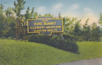 This gigantic keystone marker-shaped, two-paneled sign announced to highway travelers that they had reached Kane Summit, the highest peak in Pennsylvania.