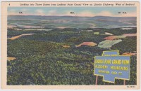 This postcard shows Lookout Point Grand View and its large marker. The sign was cut from a separate photograph, and placed on top of the image of the view.