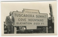 A snapshot of an unidentified tourist at the Tuscarora Summit large marker. (Radnor Historical Society)