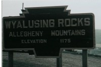 This view of the Wyalusing Rocks large sign appeared in a 1959 home movie, which can be viewed in its entirety here.