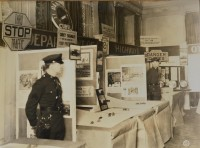 "This photograph appears to show a Pennsylvania Department of Highways display at a conference or convention. Many official state highway signs were on display, from ""Stop"" signs to Keystone Markers. (Pennsylvania Department of Highways Collection, Pennsylvania State Archives: RG-12 OL 5-0603 box 4, #2116)"