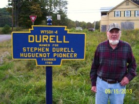 2014 photo of marker and DeWayne Grover, local resident who restored the post