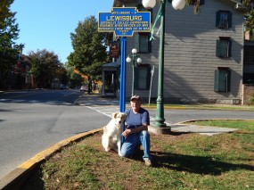 October 2016 photo shows Jim Carn after repainting the marker