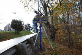 November 2016 photo by Mike Wintermantel shows the sign being reinstalled