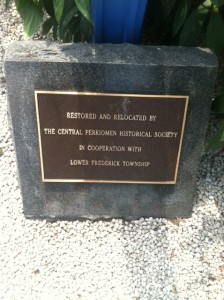 "Inscription reads: ""Restored and relocated by the Central Perkiomen Historical Society in cooperation with Lower Frederick Township"""